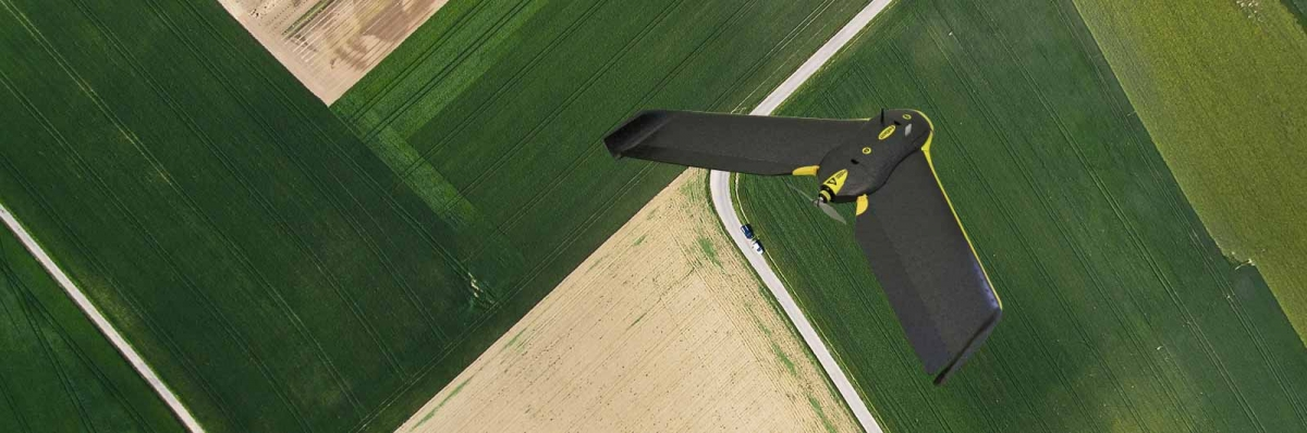 drone flying over fields and crops